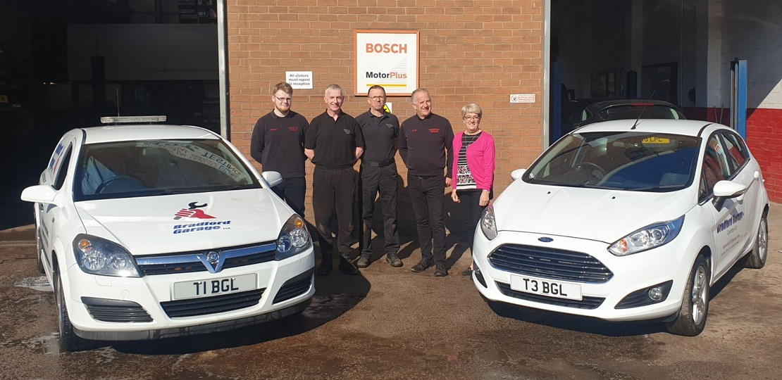 Bradford Garage team mechanics, Edge Lane, Droylsden, Manchester